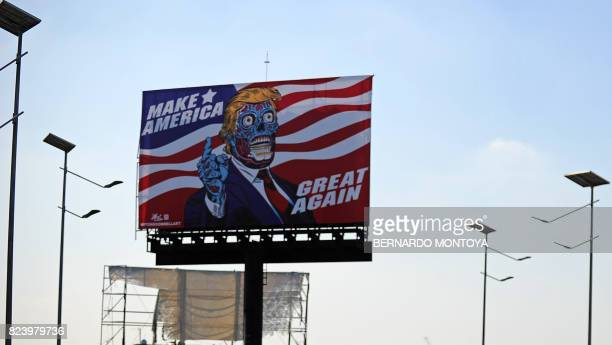 Billboard by US artist Mitch O'Connell depicting US president Donald Trump is displayed, in allusion and as a tribute to John Carpenter's 1988 cult...
