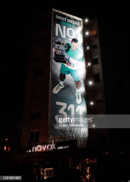 "Billboard celebrating Novak Djokovic is displayed above of family restaurant ""Novak"" on March 8, 2021 in Belgrade, Serbia."