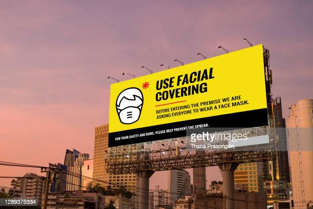 billboard covid-19 mandatory face mask sign - centers for disease control and prevention stock pictures, royalty-free photos & images