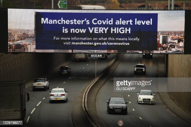 Billboard displays a Manchester City Council message about the city's Covid alert level in Manchester, northwest England, on November 26, 2020 during...