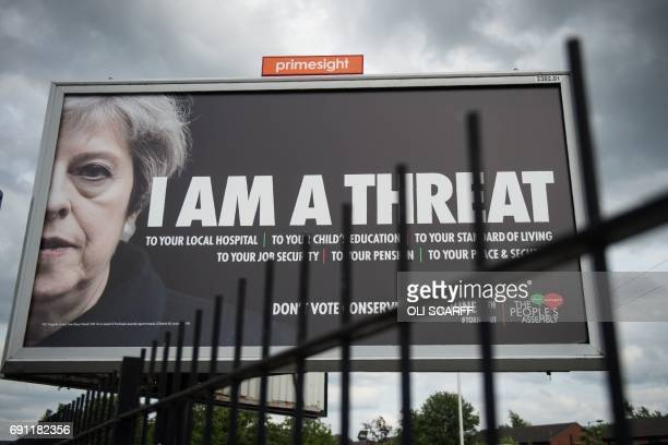 TOPSHOT A billboard displays a poster featuring an image of the British Prime Minster Theresa May which urges the electorate not to vote for the...