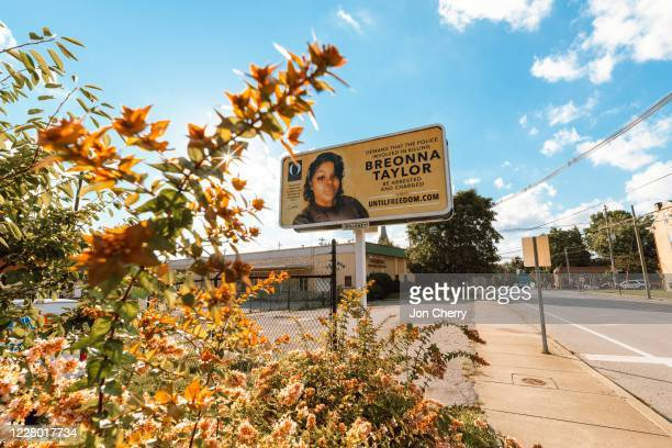 A billboard featuring a picture of Breonna Taylor and calling for the arrest of police officers involved in her death is seen on August 11 2020 in...
