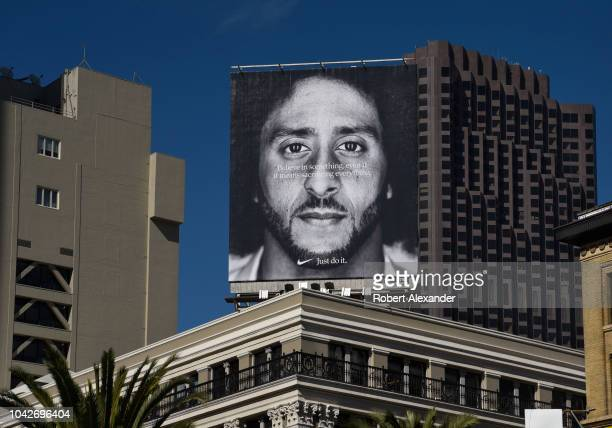 SAN FRANCISCO CALIFORNIA SEPTEMBER 12 2018 A billboard featuring a portrait of American NFL football player Colin Kaepernick mounted on top of a...