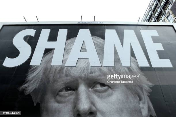 A billboard featuring an image of Boris Johnson reads the word 'Shame' on November 09 2020 in Manchester England Leaders of several northern cities...
