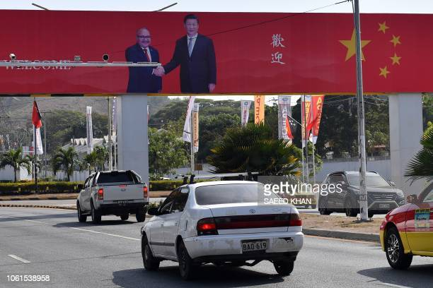 A billboard featuring Papua New Guinea's Prime Minister Peter O'Neill shaking hands with China's President Xi Jinping is displayed ahead of the...