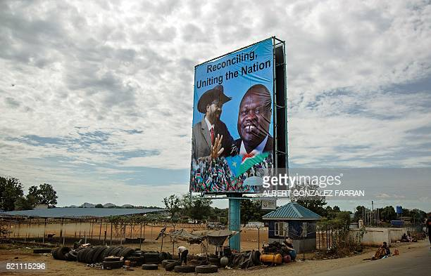 TOPSHOT A billboard featuring portraits of the South Sudan's President Salva Kiir and the opposition leader Riek Machar is displayed in Juba South...