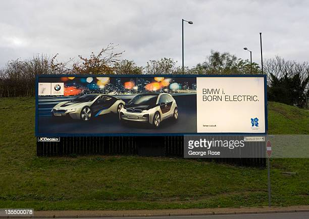 A billboard for a BMW electric car greets visitors at the entrance to Heathrow International Airport on November 18 2011 in London England Heathrow...
