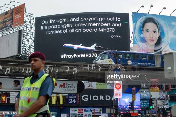Billboard for missing Malaysian Airline System Bhd. Flight 370 is displayed in Kuala Lumpur, Malaysia, on Tuesday, March 18, 2014. Malaysia, aspiring...
