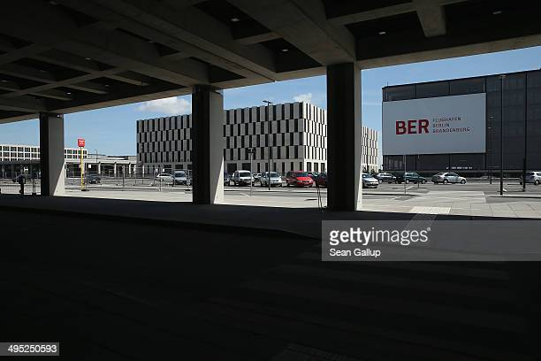 A billboard hangs neat the main terminal at the unfinished new BER Willy Brandt Berlin Brandenburg International Airport on June 2 2014 in...