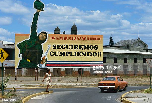 A billboard in Managua Nicaragua promotes nationalism and supports the Sandinistas Rising to power within the Nicaraguan government in the 1980s the...