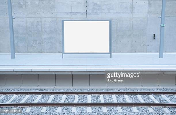 billboard in railroad station - bahnhof stock-fotos und bilder