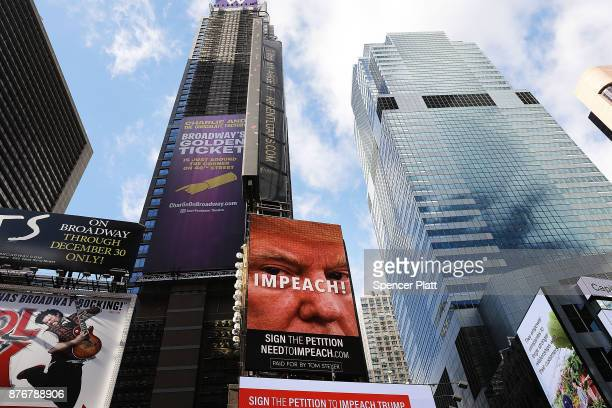 A billboard in Times Square funded by Philanthropist Tom Steyer calls for the impeachment of President Donald Trump on November 20 2017 in New York...