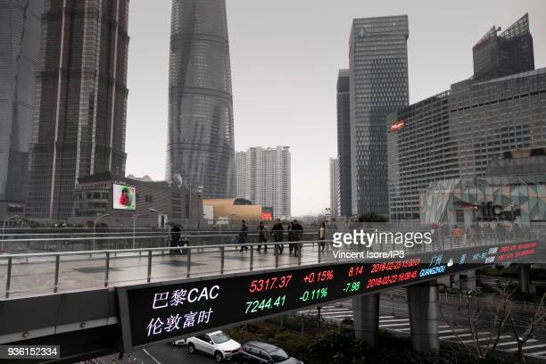 A billboard indicates the stock market prices here the French stock index CAC40 on February 24 2018 in Shanghai China China's most populous city is...