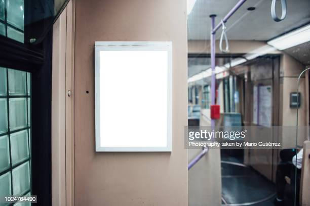 billboard inside subway train - zakenman stock pictures, royalty-free photos & images