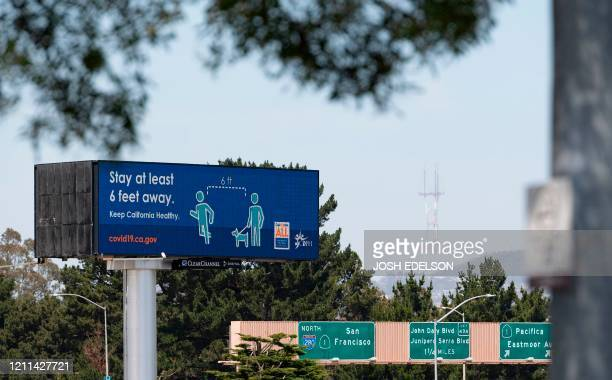 Billboard instructing people to respect social distancing is seen along Interstate 280 in Daly City, California on April 30, 2020. - The United...
