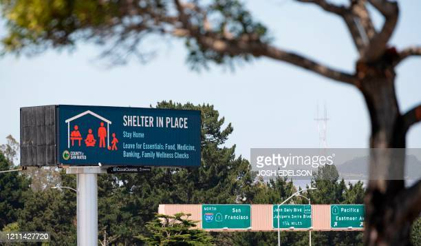 Billboard instructing people to shelter in place, is seen along Interstate 280 in Daly City, California on April 30, 2020. - The United States...