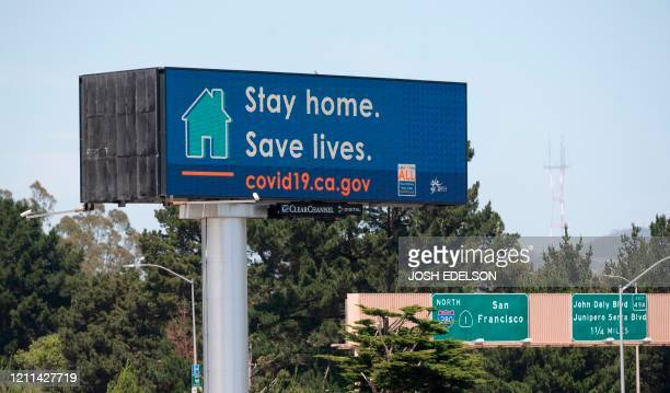 Billboard instructing people to stay home to save lives, is seen along Interstate 280 in Daly City, California on April 30, 2020. - The United States...
