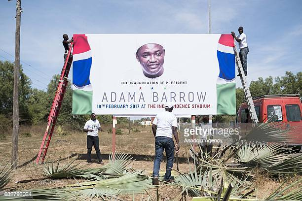 A billboard is prepared for an invitation of the event which will be held at Independence Stadium on February 18 for Gambia's new president Adama...