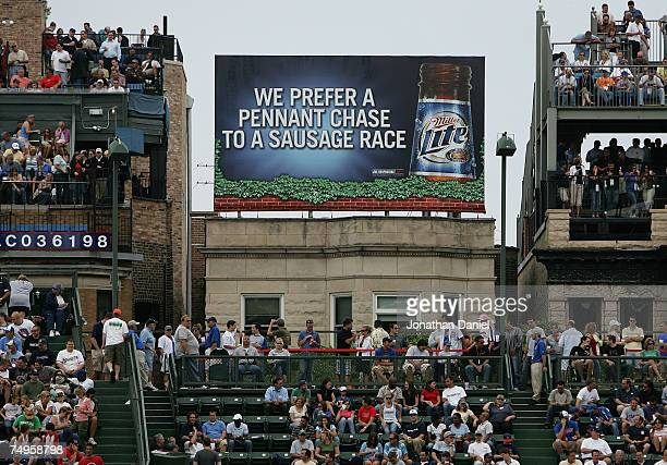 A billboard is visible on the roof of a building outside of Wrigley Field during a game between the Chicago Cubs and the Milwaukee Brewers at Wrigley...