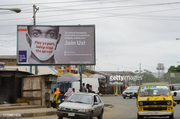 Billboard mounted at Ikotun-Ijegun Road to campaign against the spread of the COVID-19 coronavirus is seen in Alimosho area in Lagos, on April 22,...