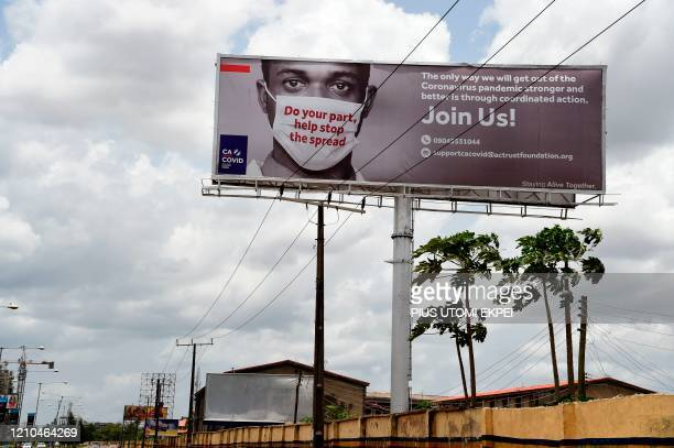 Billboard mounted at the Airport Road to campaign against the spread of the COVID-19 coronavirus is seen in Ikeja in Lagos, on April 20, 2020. - The...