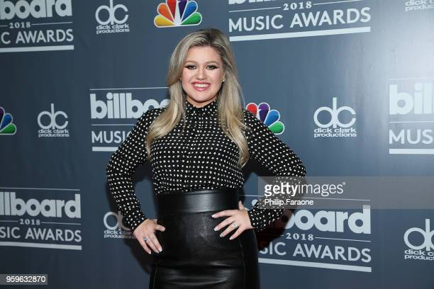 Billboard Music Awards host Kelly Clarkson attends a photo call at Universal Studios Hollywood on May 17 2018 in Universal City California