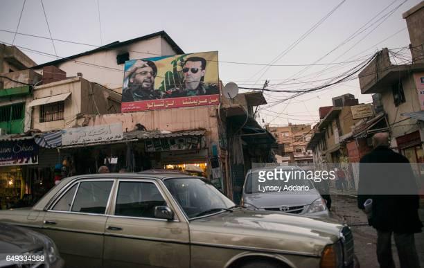 A billboard of Hezbollah leader Hassan Nasrullah and Syrian President Assad hangs over the streets in the Lebanese town of Baalbak Lebanon Jan 22...