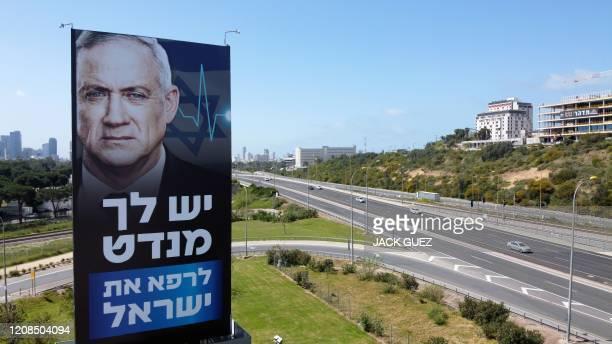 Billboard of Israeli Parliament speaker Benny Gantz is pictured along a highway in the Mediterranean costal city of Tel Aviv, on March 29, 2020. -...