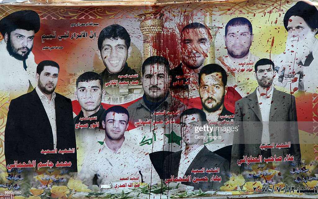 A billboard of Sadr followers which were killed in 2007 is covered in blood near Mohsin al-Hakim Shiite mosque, the scene of a bombing on April 23, 2010 in Baghdad, Iraq. A series of bombings rocked a market and Shiite mosques as worshippers departed Friday Prayer services, killing at least 60 people and wounding many more.