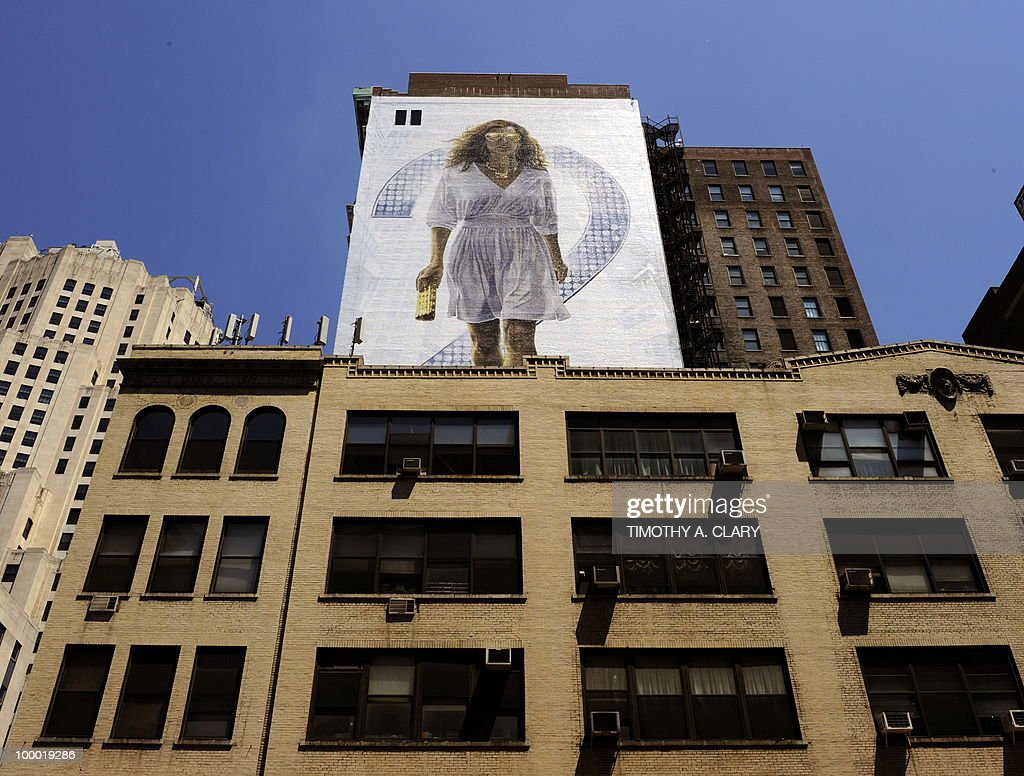 A billboard of Sarah Jessica Parker starring as Carrie Bradshaw is painted on the side of a building in New York May 20, 2010 to promote the new movie 'Sex and the City 2' which will premier in New York City next week. The movie is based on the hit tv show 'Sex and the City'.