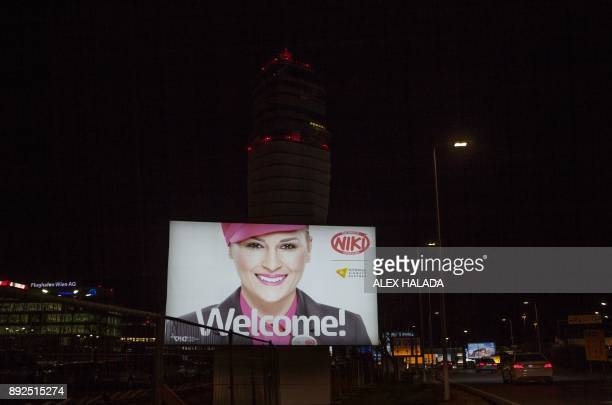 A billboard of the insolvent airline Niki Luftfahrt GmbH is pictured in the front of the airport tower at the Vienna International Airport in...