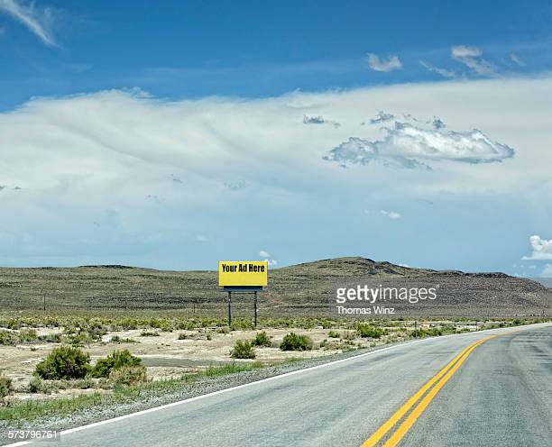 billboard on a nevada highway - billboard highway stock pictures, royalty-free photos & images