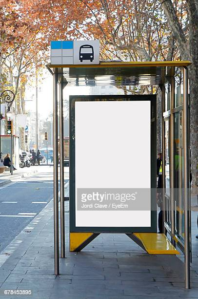 billboard on bus stop at sidewalk - vertical stock pictures, royalty-free photos & images