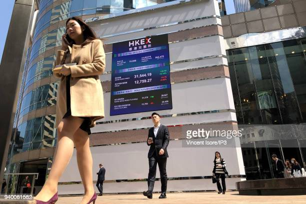 A billboard on the front of the building shows the stock market trends for the different companies listed on February 27 2018 in HongKong China...