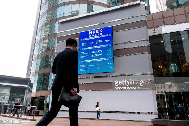 A billboard on the front of the building shows the stock market trends for the different companies listed on March 01 2018 in HongKong China HongKong...