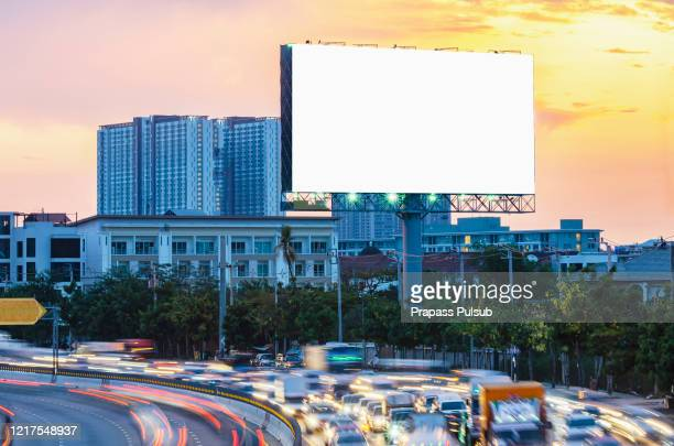 billboard on the highway during the twilight with city background with clipping path on screen - billboard highway stock pictures, royalty-free photos & images