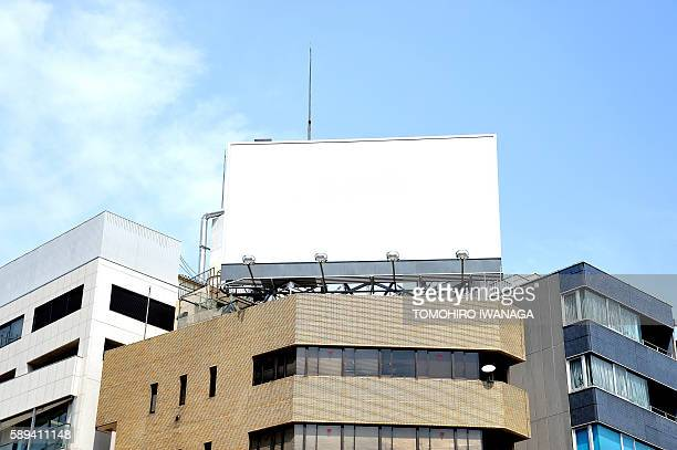 billboard on top of building - 商業看板 ストックフォトと画像