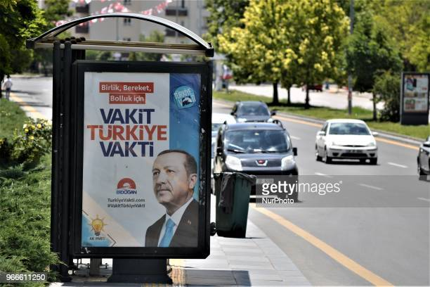 A billboard picturing President Recep Tayyip Erdogan is posted by the ruling Justice and Development Party for the early presidential and...