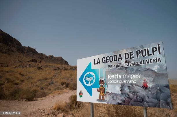 A billboard points the way to the giant geode of Pilar de Jaravia in Pulpi on August 2 2019 The geode of Pulpi is listed as the largest in Europe and...