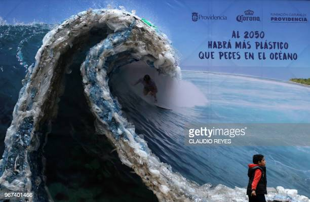 TOPSHOT A billboard portraiting a man surfing a wave made out of plastic bags and bottles to denounce ocean's pollution is pictured in Santiago on...