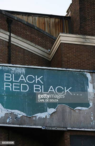 Billboard poster is pictured in Aldershot in Hampshire in southern England, on October 1, 2008. Britain's economy experienced zero growth in the...