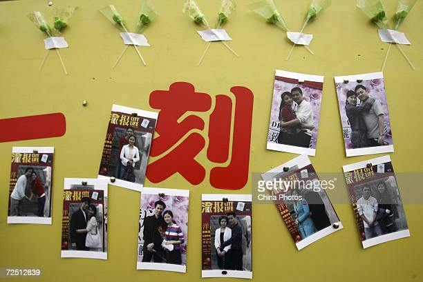 A billboard posts pictures of people who successfully made friends during a matchmaking activity to mark the Singles Day November 11 2006 in...