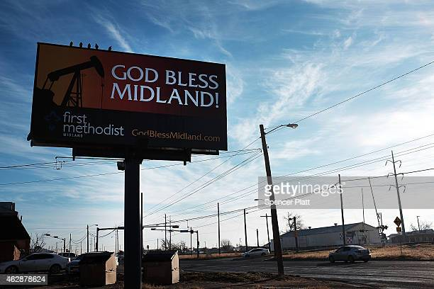A billboard promotes the oil industry along a road in Midland on February 6 2015 in Midland Texas As crude oil prices have fallen nearly 60 percent...