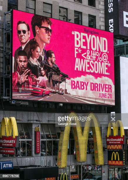 A billboard promoting the new movie 'Baby Driver' is viewed above a McDonald's restaurant in Times Square on June 10 2017 in New York New York With a...