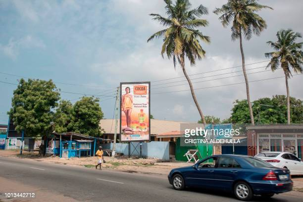 A billboard publicises new natural cocoa products to restore natural skin colour on Oxford Street in Accra on July 2 2018 Africa is experiencing a...