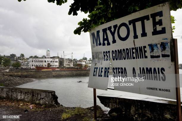 A billboard reading Mayotte is Comoran and it will be forever is seen in Moroni the capital of Grand Comores on 27 March 2008 Comorans staged angry...