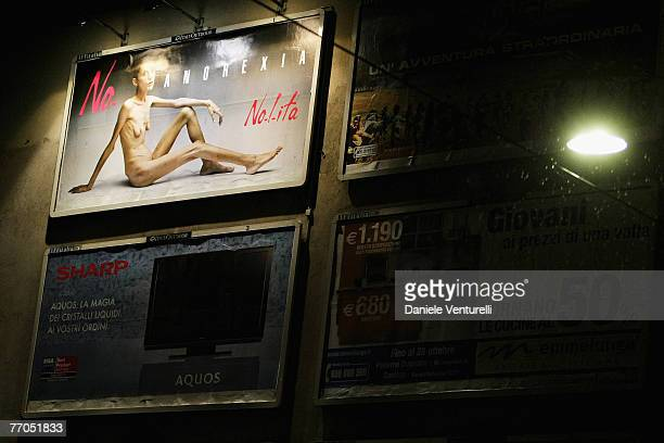 A billboard reading No Anorexia shows an Italian advertising campaign featuring French comedian and anorexia sufferer Isabelle Caro photographed by...