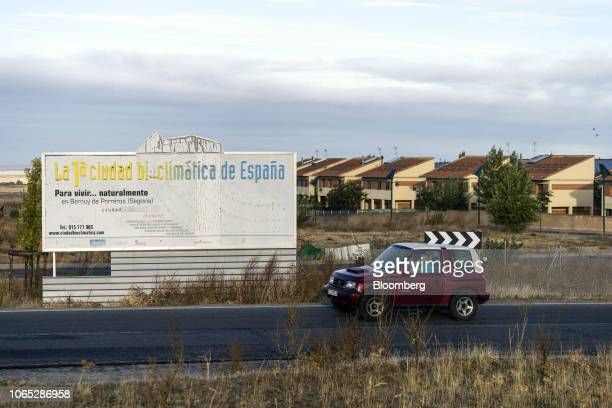 A billboard reading 'Spain's first bioclimatic city' sits on the perimeter of a semiabandoned residential development in Bernuy de Porreros near...