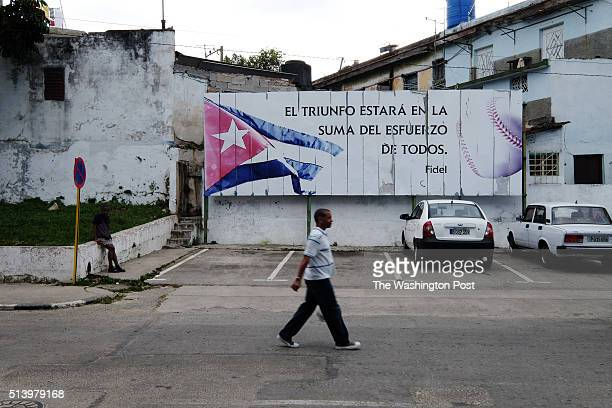 A billboard roughly translated 'triumph is the sum of all our struggles across from the Latin American Stadium in Havana Cuba on February 22 2016...