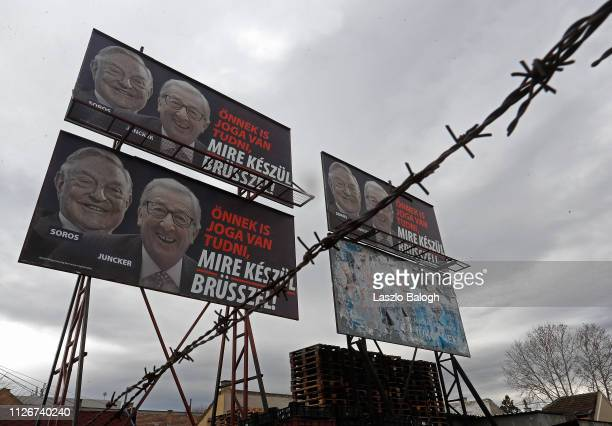 A billboard seen with portraits of European Commission chief JeanClaude Juncker and Hungarianborn US billioner George Soros and a slogan reading You...
